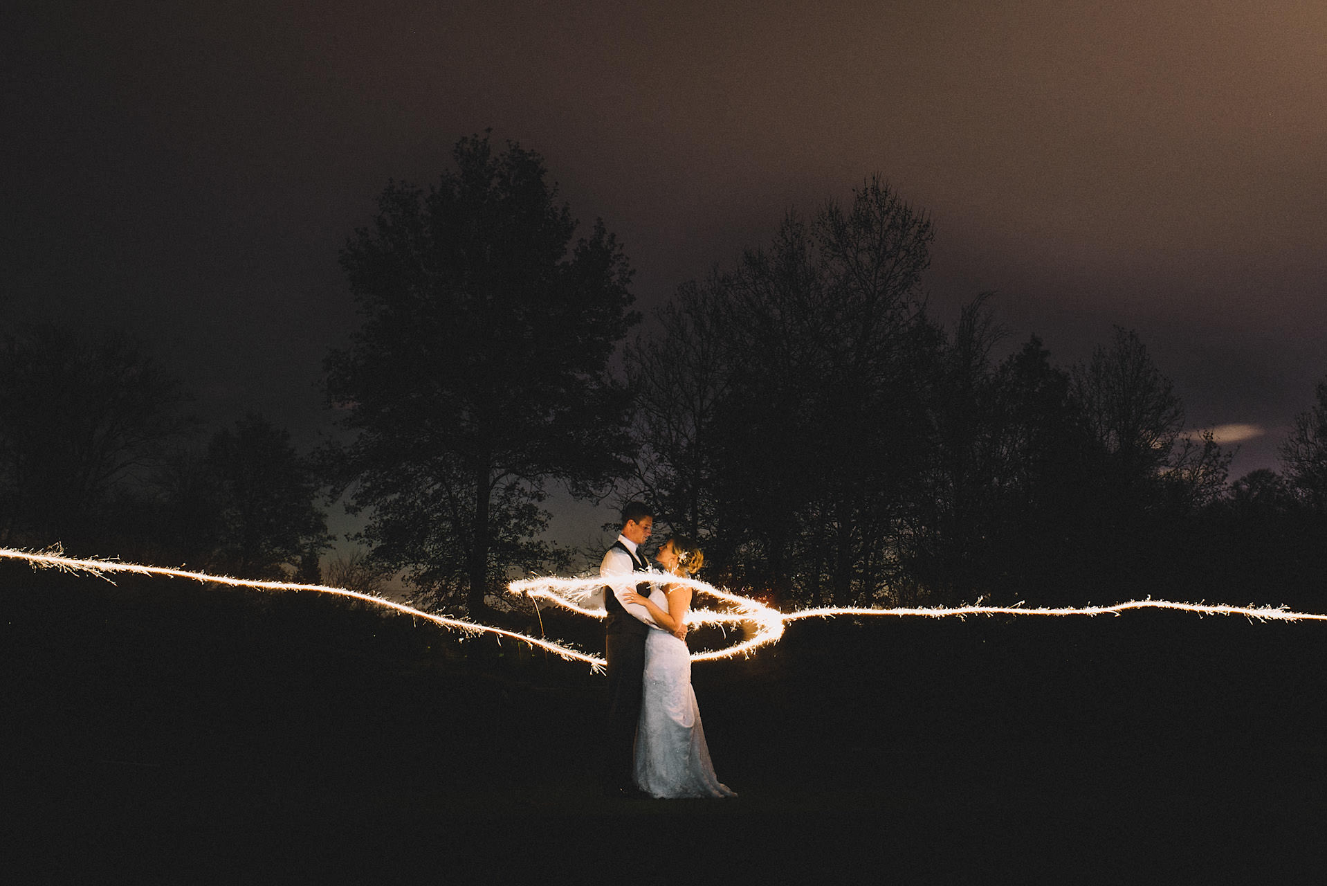 outdoor sparkler portrait in a forest