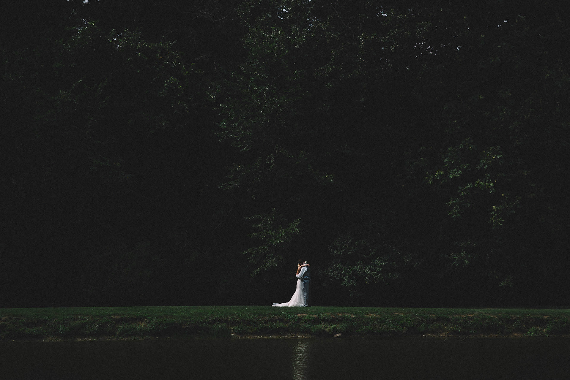 intimate bride and groom first look by a lake
