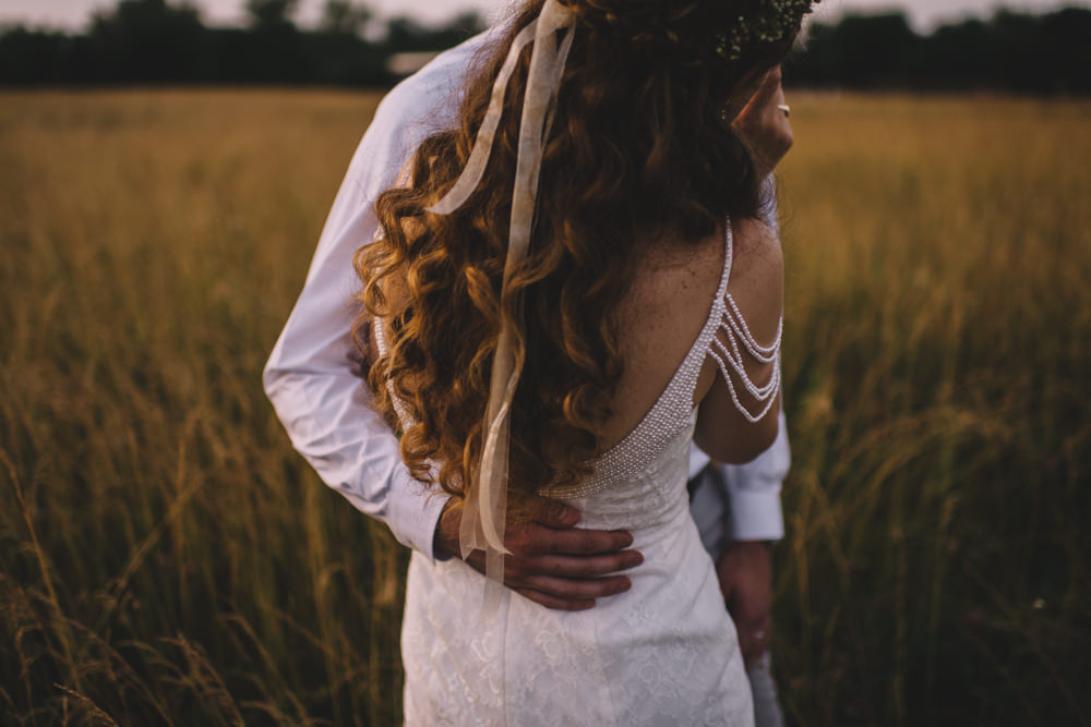 sunset wedding photography at old blue rooster wedding with a flower crown