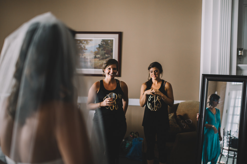 bridesmaids laughing at Wedgewood Country Club wedding photography in Columbus