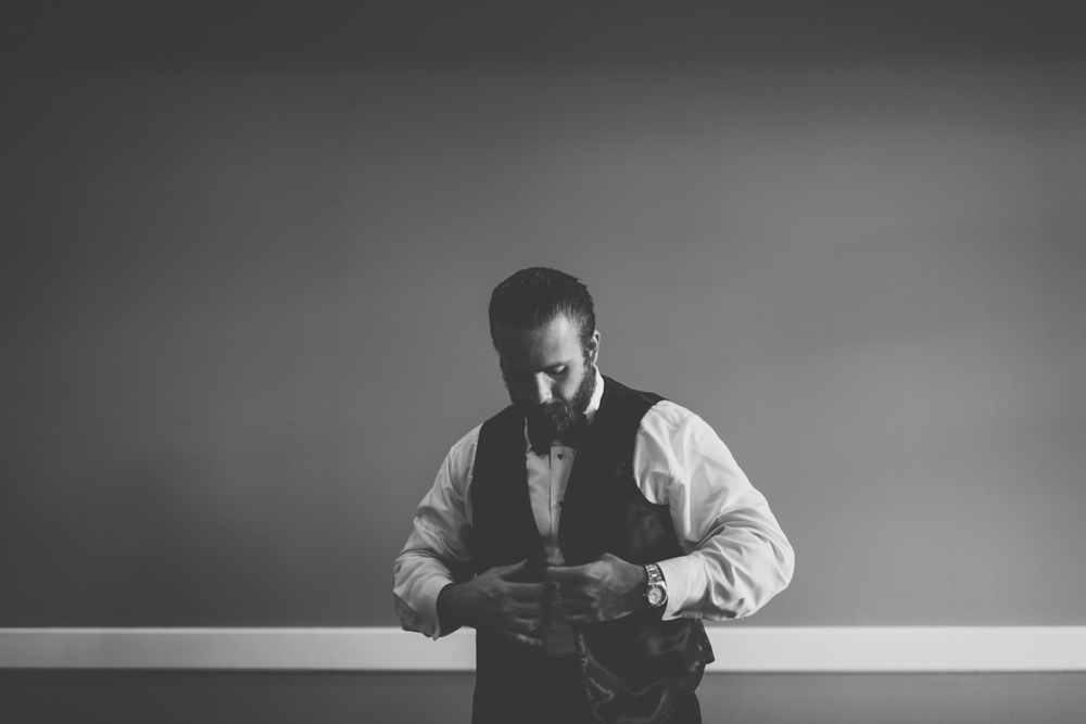 Groom getting dressed at Wedgewood Country Club wedding photography in Columbus