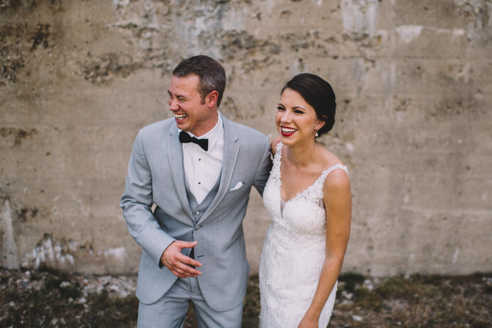 couple laughing together at station 67 wedding photography in columbus ohio