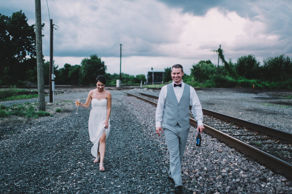 bride and groom walking together during sunset in columbus