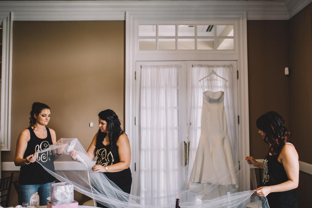 bridesmaid steaming a wedding veil