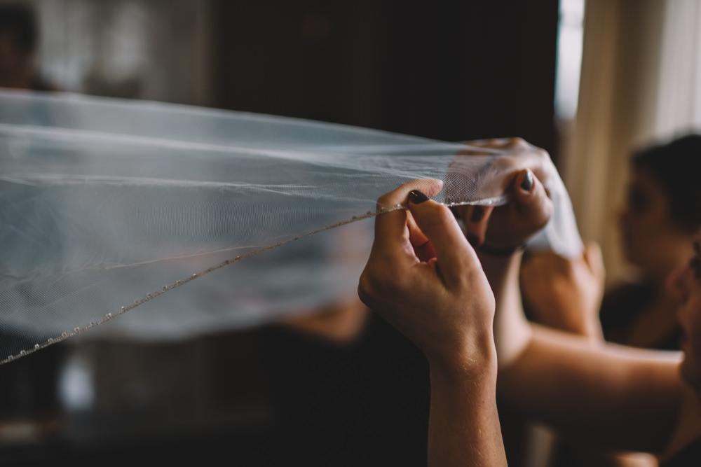 brides hands holding her veil