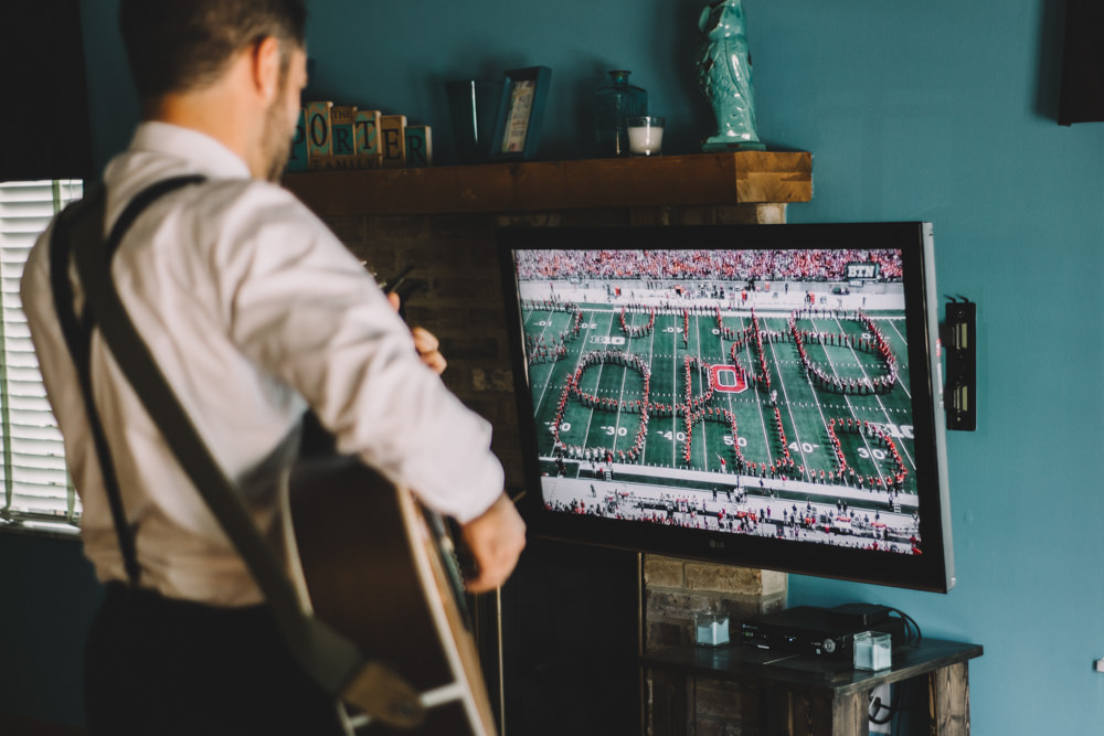 ohio groom playing guitar during an ohio state football game
