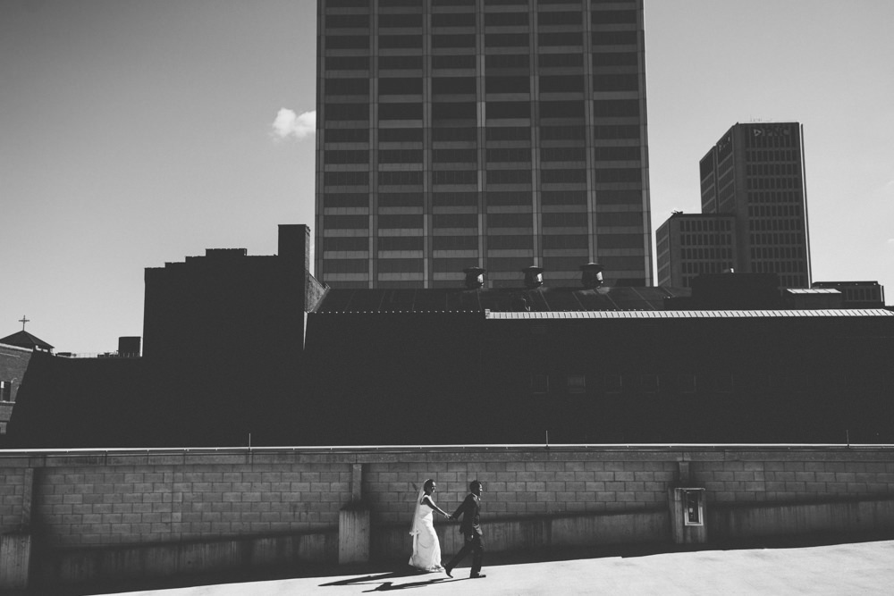 bride and groom walking through the sunlight in columbus ohio