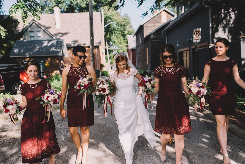 Columbus bride walking through the streets with her bridesmaids