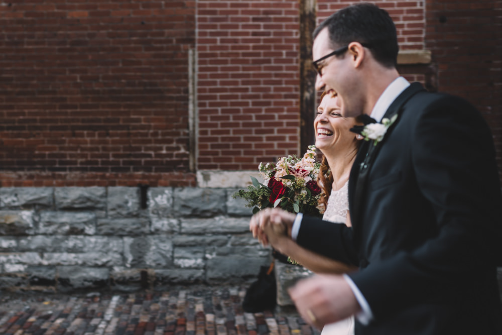 bride and groom recessional laughing together