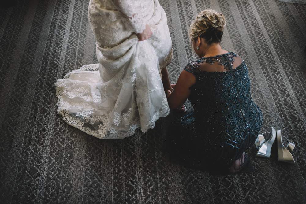 bride's mom putting her shoes on for her wedding in columbus, ohio