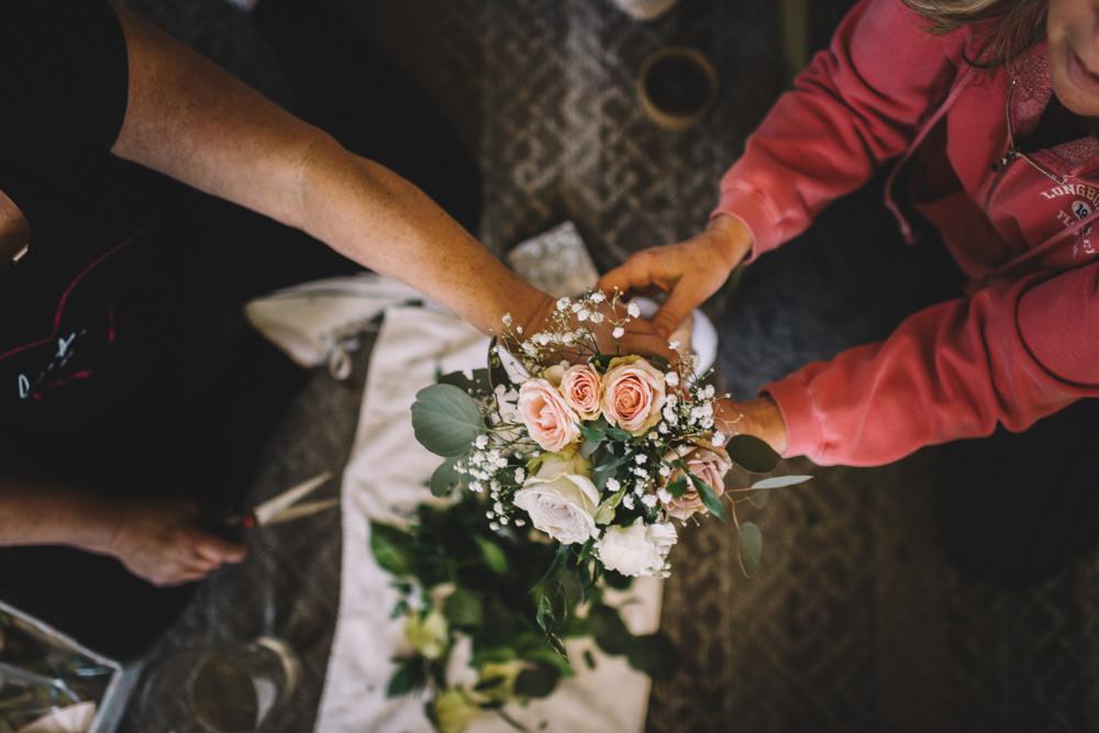 bride's aunts creating bouquets