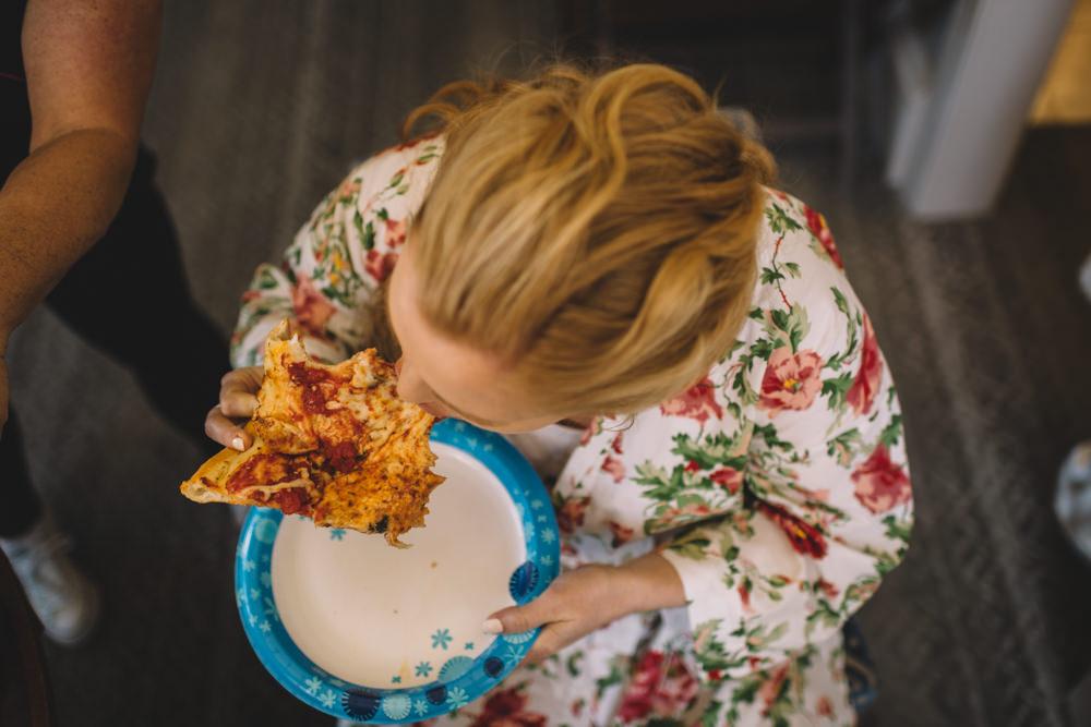 bride eating pizza in columbus ohio wedding